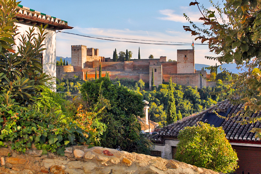 la-alhambra-granada-view-through-houses
